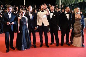 """(From L) New Zealander actor Russell Crowe, Australian actress Angourie Rice, US actor Matt Bomer, Canadian actor Ryan Gosling, US director Shane Black, US producer Joel Silver and US producer Karyn Fields pose as they arrive on May 15, 2016 for the screening of the film """"The Nice Guys"""" at the 69th Cannes Film Festival in Cannes, southern France. / AFP / ANNE-CHRISTINE POUJOULAT"""