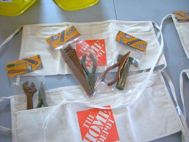 favors: cheap plastic hardhats, kid-sized Home Depot aprons {under 1 buck} and chocolate tools {homemade using a candy mold}