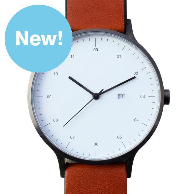 Instrmnt 01-A (gunmetal/tan) watch by Instrmnt. Available at Dezeen Watch Store: www.dezeenwatchstore.com