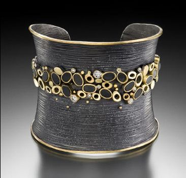 Cuff | Judith Kaufman. 22k yellow gold, 18k green gold, oxidized silver and black onyx.