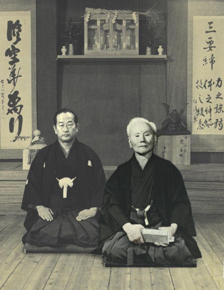 Sensei Gichin Funakoshi (1868-1957) (founder of Shotokan karate) and sensei Masatoshi Nakayama (1913-1987)