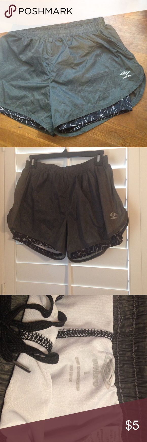 Gray shorts with built in spanx Lightweight. Size L but could fit a M (it has draw strong and stretchy waist). Worn a couple of times, great condition Umbro Shorts
