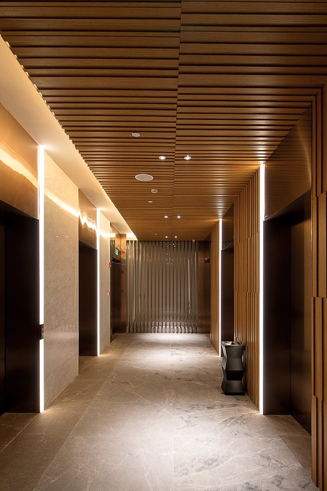 Delicious lift lobby, warm timbers and  luxury. MOK Design & Associates Limited
