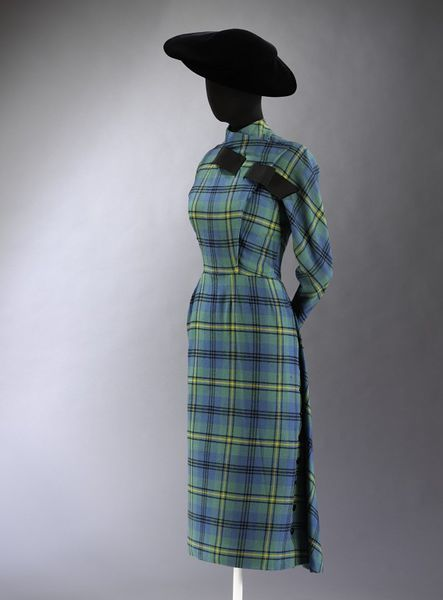 Day dress of Johnston woollen tartan, designed by Jacques Fath, Paris, 1949-1950, In 1949, Lady Alexandra commissioned one of Fath's most popular designs of the season, but requested that it be made up in her husband's family tartan. She purchased the hand-woven and naturally-dyed fabric from Scotland herself. The design features typical Fath motifs such as a flying panel at the back and decorative buttons and bows.