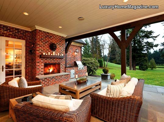 Large Covered Outdoor Patio With Fireplace Brick
