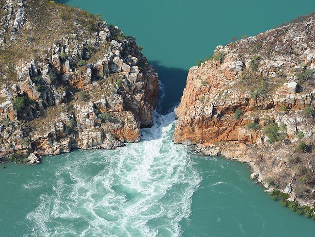 The horizontal waterfalls in the Kimberleys in Western Australia are a natural phenomenon caused by water surging between two narrow island gaps. The tides create the effect of a flat waterfall flowing horizontally across the face of the ocean.