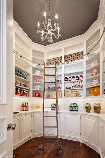 Luxury Kitchen Pantry.  Marble, chandelier, ladder so you can reach everything. Could you imagine?