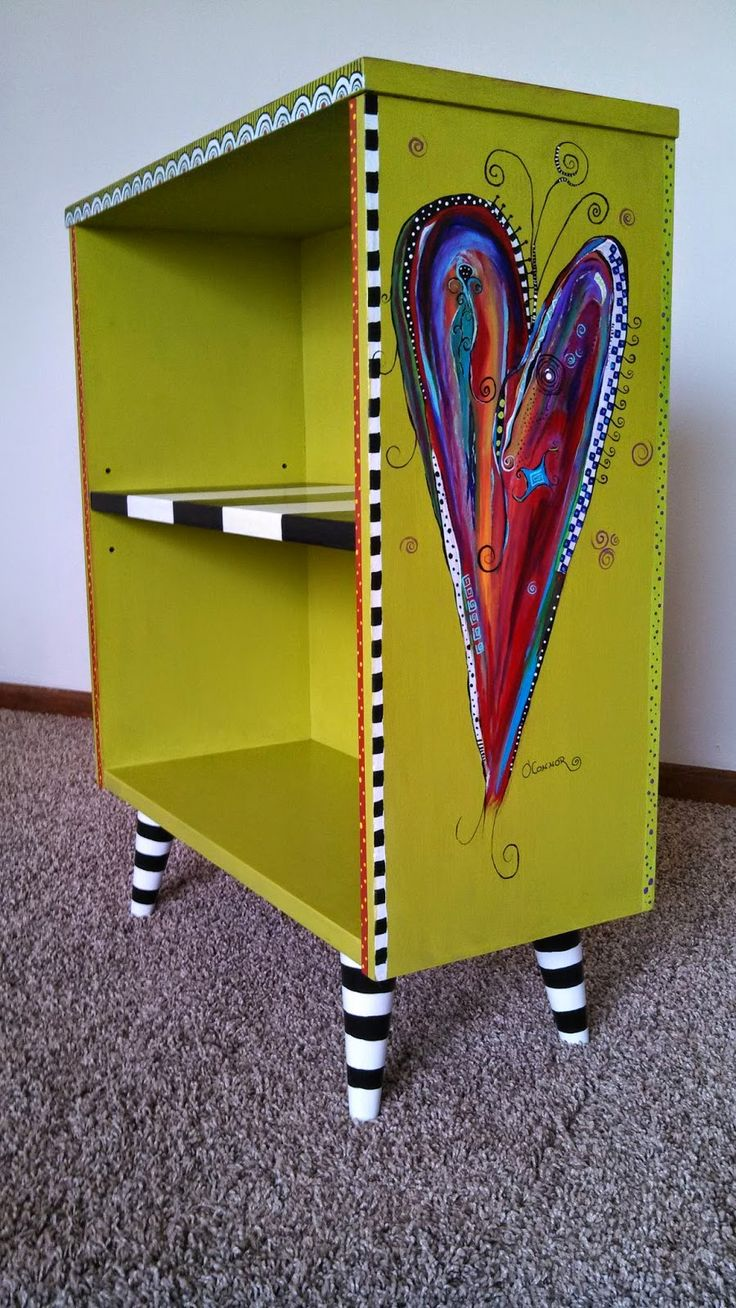 Bookcase revamped by Carolyn's Funky Furniture  Absolutely LOVE the  Wicked Witch's striped stocking theme.
