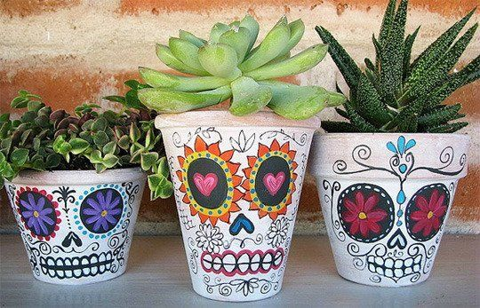10 DIY Painted Planter Ideas | Apartment Therapy - Dia de los Muertos planters. So colorful!