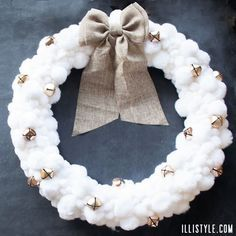 White Pom-pom Winter Wreath Tutorial from Illi Style (can leave the bells off to be more generic winter seasonal than Christmas-y)