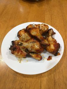 A delicious plate of honey spiced chicken drumsticks
