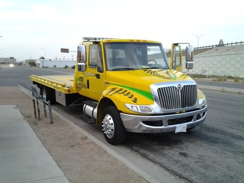 2011 International Extended cab air brake air ride flatbed tow truck Towing and auto transporter insurance.  www.TravisBarlow.com