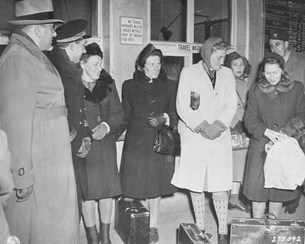 Four Polish women arrive at the train station in Nuremberg to be prosecution witnesses at the Doctors Trial.