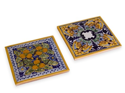 "Pure Talavera Spanish Garden Trivets rival the vivid beauty found in a Mediterranean countryside garden, so your morning cup o' joe or evening cocktail will be far from ordinary.    Includes two 6"" square artisan-crafted, one-of-a-kind Talavera tile trivets with cork backing; pair perfectly with Spanish Garden Talavera Coasters."