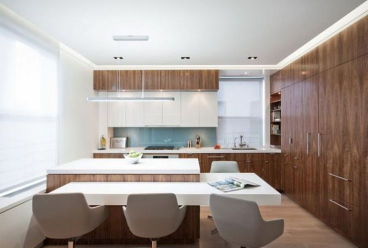 The white sleek kitchen bar attached to the super bold kitchen island defines the l shaped layout and also strikes with contemporary and modern feel in the overall stylish and modern kitchen. Description from rilane.com. I searched for this on bing.com/images