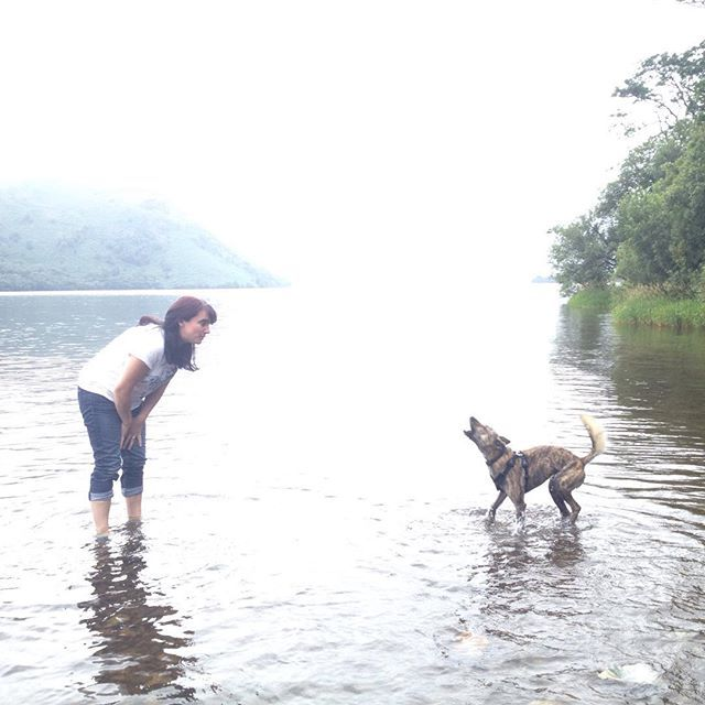 My sister communing with dog and lake