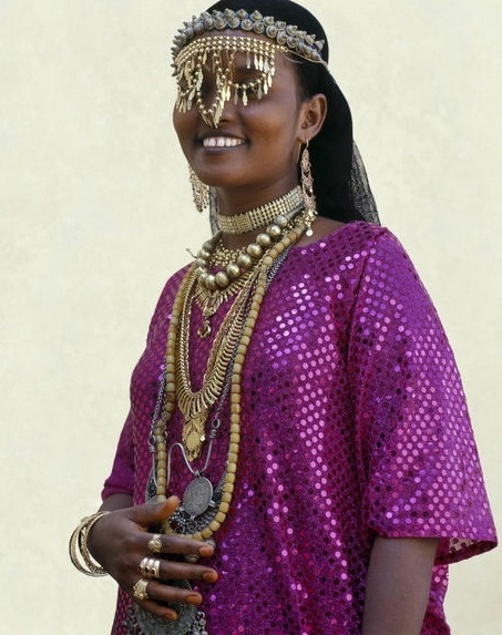 Africa    Djibouti, Tadjoura. An Afar girl from the Sultanate of Tadjoura wears exotic gold jewellery for marriage and other important celebrations. Although some of this jewellery will be made locally, other pieces will have been bought in Arabia, Ethiopia and the Indian sub-continent.   Photographer Nigel Pavitt, © John Warburton-Lee