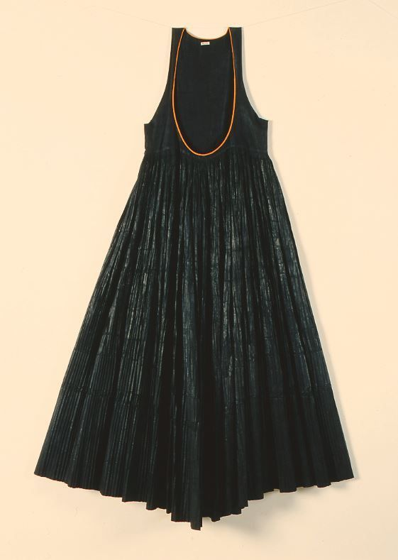 """Doula foustani"". Pleated dress. Kymi, Euboea, Greece. Late 19th century. Peloponnesian Folklore Foundation Collection, Nafplion. Donated by Ioanna Papantoniou. 1976.6.122. ""Doula"" dress. Black chintz pleated dress with straps."