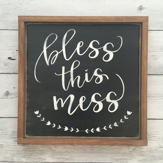 Bless This Mess  This sign is shown in distressed black with white words, and is…