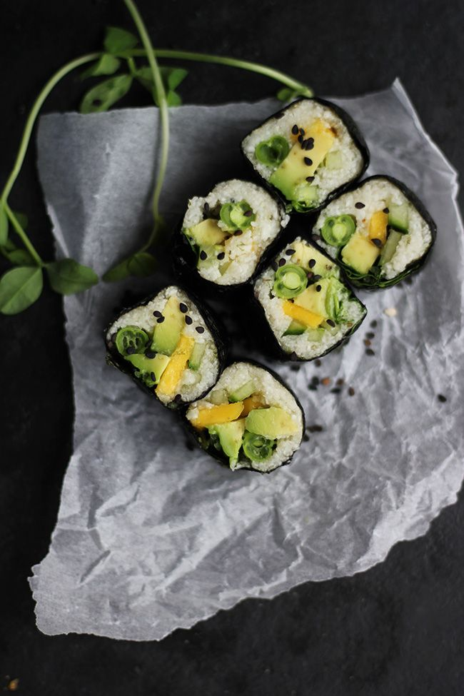 Avocado, mango, greens and cauliflower rice sushi