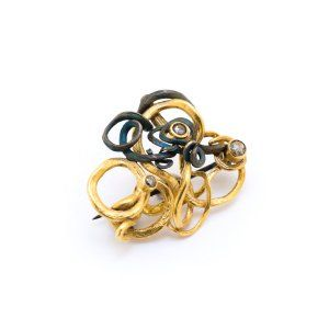Sifis Jewellery - A real vine branch brooch made out of Gold and Oxidised Silver with 3 Diamonds strategically placed.