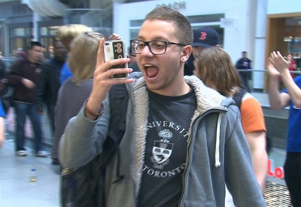 A happy iPad lover films his entrance to the Apple Store at the Eaton Centre in Toronto, Friday, March 16, 2012. ctvnews dennan5224