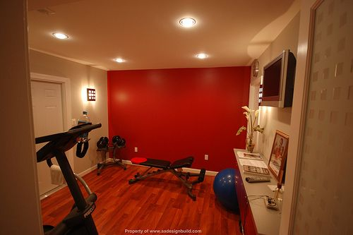 What a great home workout space. Love the red wall!