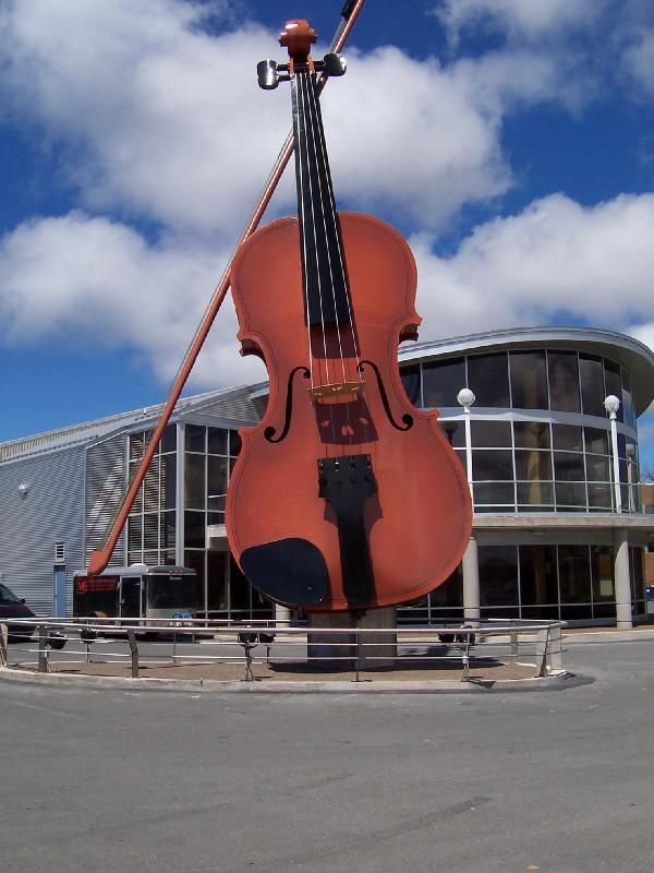 The World's Largest Violin (and bow) is located on the Sydney waterfront in Cape Breton. Cape Breton is one place in Canada that you are almost always within earshot of fiddle music. Cape Breton fiddling is a regional violin style which falls within the Celtic music idiom. Cape Breton Island's fiddle music was brought to North America by Scottish immigrants during the 18th and 19th century.