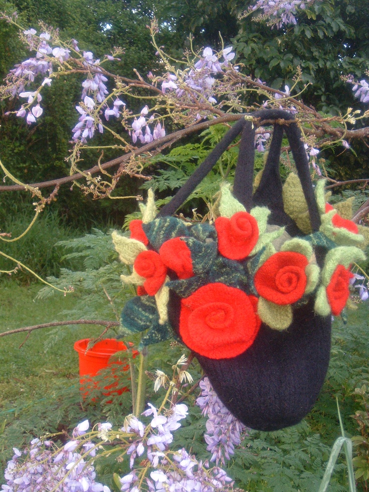 Hand knitted and fulled bag with hand knitted roses.