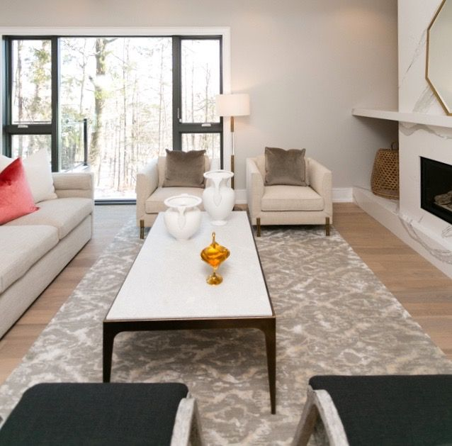 #Highview house from #BryanInc seen on #HGTVCanada. Furniture by Cocoon: #Melange chair, #Hancock cocktail table, #GraecianAmphorosa vases, #Camden lounge chair, #Severn floor lamp. #bryanbaeumler #sarahbaeumler