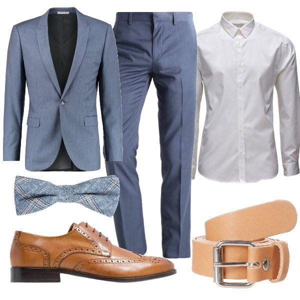 Outfit per una occasione formale composto da giacca skinny, pantaloni alla caviglia e camicia classica. Completano il look la cintura in pelle e le stringate color cognac. Sdrammatizza e dona un tocco di originalità il papillon con fantasia a quadri.