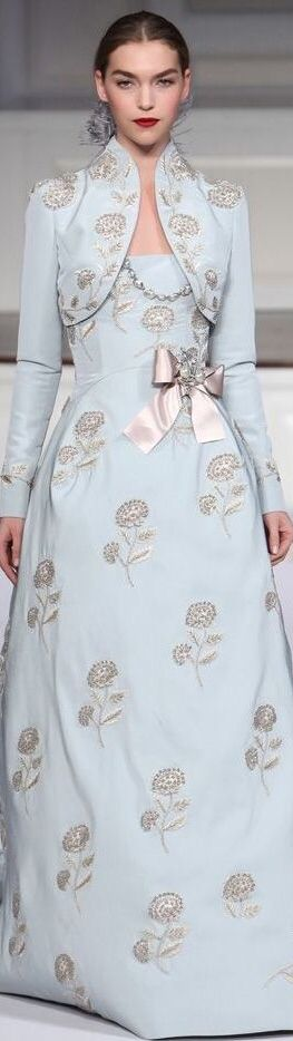 Such an embroidered dress and bolero jacket would be fantastic with silver or dark hair! Oscar de la Renta has delivered style plus elegance with the shimmery fabric and silver accent motif. Imagine this in candlelight!