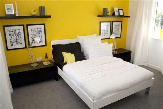 bright yellow feature wall master bedroom - like the bedside set