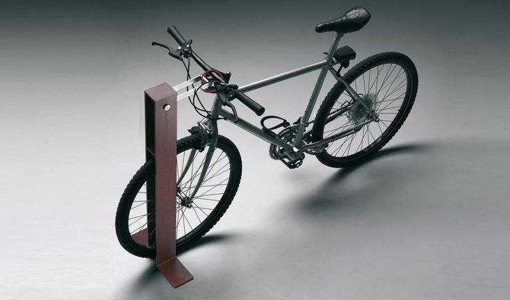 Bike stand made from shaped steel plate, with a brushed and electropolished stainless steel movable connecting rod, particularly useful to attach a lock to the bike frame.