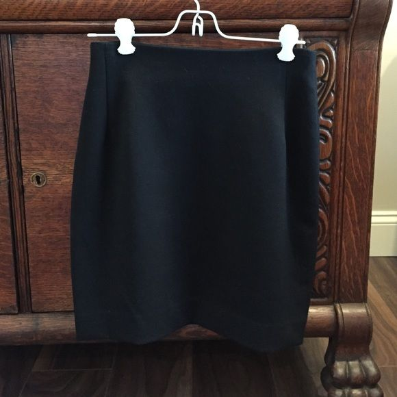 """Carroll Paris Little black skirt 53% poly 43% wool 4% Lycra black skirt with front seams, back zip and kick pleat . Small rib textured fabric. 27"""" waist, 18"""" to hem. Made in France . Add raw sleeveless top from my closet for 5% off on both. Caroll Paris Skirts Mini"""