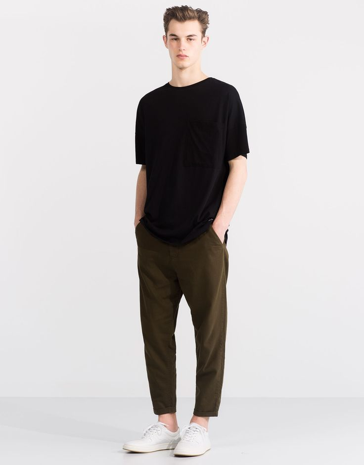 mens fashion, black t shirt and khaki green trousers