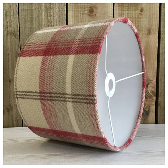 This stylish lightshade / lampshade is handmade in our Bristol workshop from a cranberry red colour tartan fabric. The lightshade is also available with a diffuser, please follow the link below ▪️ Shade & diffuser - ▪️Matching cushion covers- ▪️Need a swatch of this fabric? Please order from this listing- https://www.etsy.com/uk/listing/514198455/sample-of-fabric ▪️Fabric - Cranberry red tartan fabric ▪️Made to order within 5 working days ▪️ Measures -...