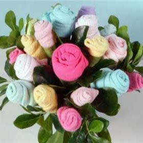 Flowers make a lovely centerpiece at a baby shower, but instead of the real thing, give the mother-to-be a bouquet of blooms from baby onesies and wash cloths as a gift. See how easy it is to make one.