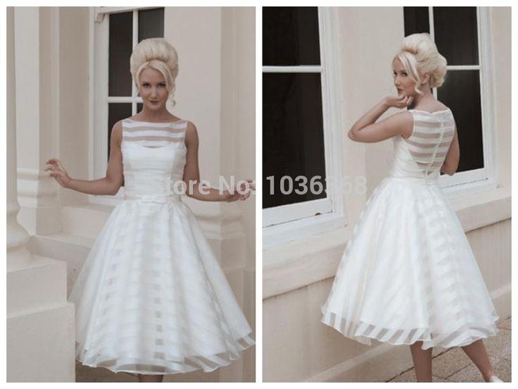 tea length full circle skirt of satin and organza striped sleeveless wedding dress
