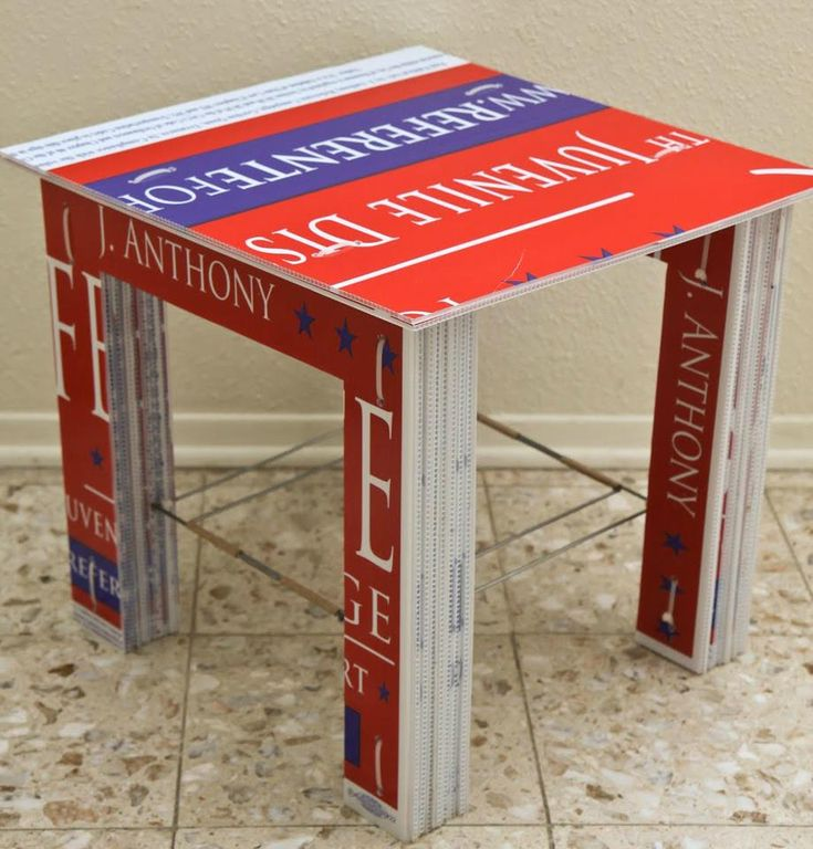 Recycle - Reuse: Re-purpose Plastic Political Campaign Signs  A table made from reclaimed corrugated plastic political campaign signs, yard sign h-frames, zip ties and packing tape