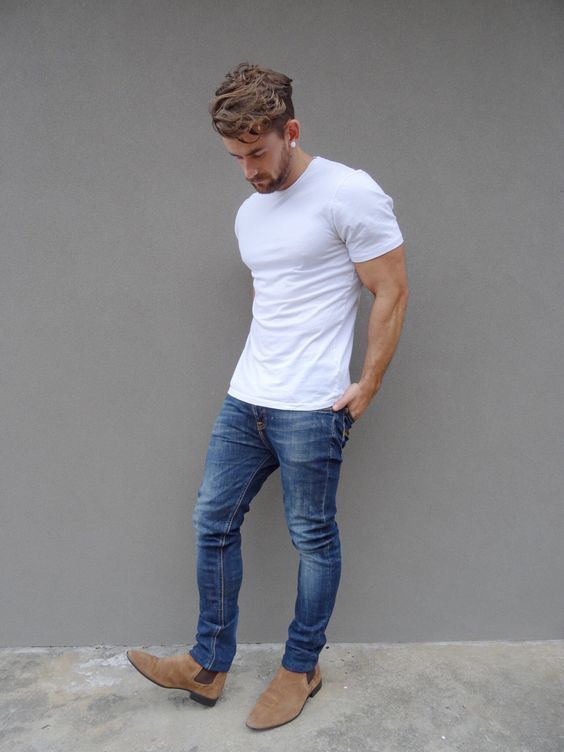 Nail off-duty dressing with this combination of a white crew-neck t-shirt and blue jeans. Smarten up your outfit with khaki suede chelsea boots.   Shop this look on Lookastic: https://lookastic.com/men/looks/white-crew-neck-t-shirt-blue-jeans-tan-suede-chelsea-boots/17617   — White Crew-neck T-shirt  — Blue Jeans  — Tan Suede Chelsea Boots