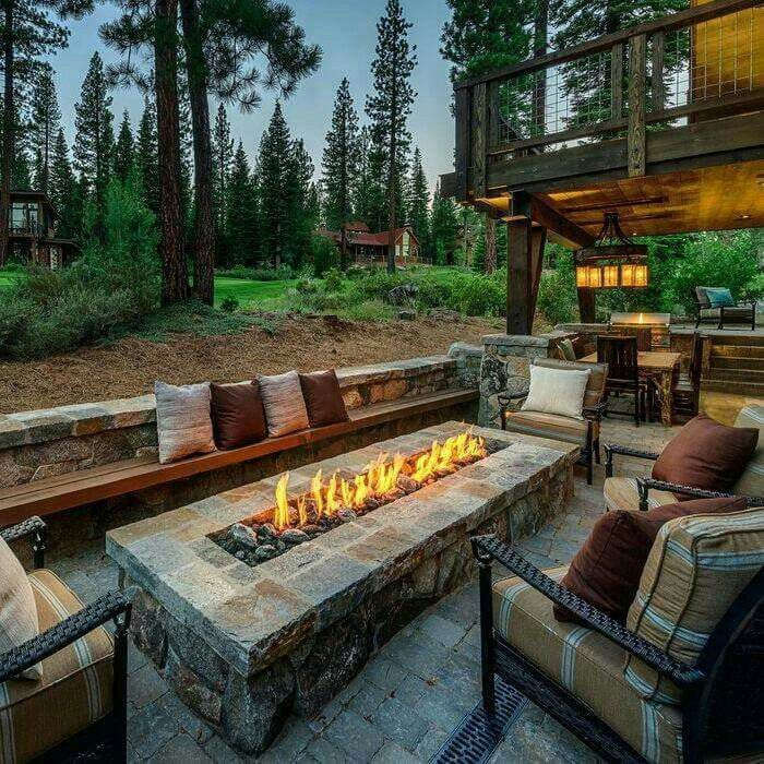 Pin this Outside patio with rectangular firepit...