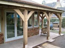 oak canopy - poss wrap around side from front door to utility door to give shelter from rain?