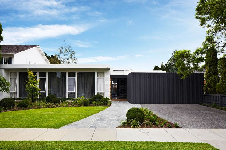 "While the front of the 1960s house has been retained, it was given an update with the cool white of [Wattyl](http://www.wattyl.com.au/en/?utm_campaign=supplier/|target=""_blank"") Flokati paint and the garage is now clad in timber battens painted in dark grey [Dulux](http://www.dulux.com.au/?utm_campaign=supplier/