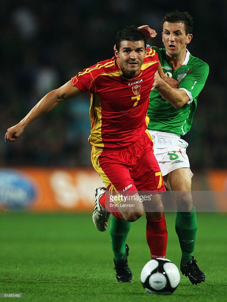 <a gi-track='captionPersonalityLinkClicked' href=/galleries/search?phrase=Liam+Miller&family=editorial&specificpeople=212726 ng-click='$event.stopPropagation()'>Liam Miller</a> of the Republic of Ireland holds back Simon Vukcevic of Montenegro during the FIFA 2010 World Cup European Qualifying match between the Republic of Ireland and Montenegro at Croke Park on October 14, 2009 in Dublin, Ireland.