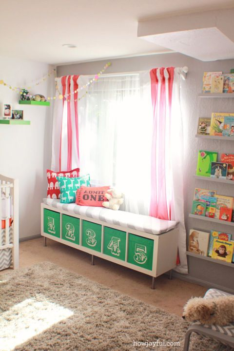 Add seating and storage at the same time by transforming a plain white bookshelf into a bench complete with green numbered cubbies that offer tons of space for toys or books. See more at How Joyful »