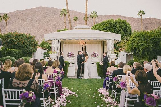 Gorgeous desert wedding with purple accents. Photo by Dave Richards via Ruffled.