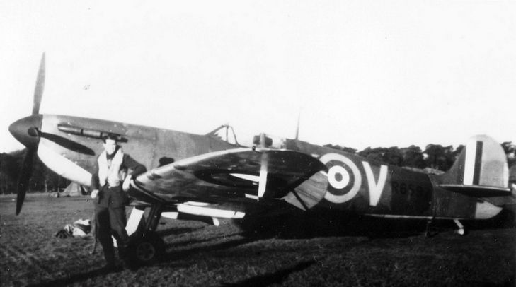 "P/O John D ""The Bish"" Bisdee stands by Spitfire Mk I UM-V at RAF Warmwell in 1940. The aircraft was flown by P/O Arthur R ""Watty"" Watson on 28 November, falling dead when his parachute tore as it snagged on the airframe on bailing out after combat with enemy fighters near Arne. The 19-year-old pilot had rejoined No 152 Squadron RAF from sick leaf 20 days earlier, having acquitted himself with 3 destroyed and 1 damaged."