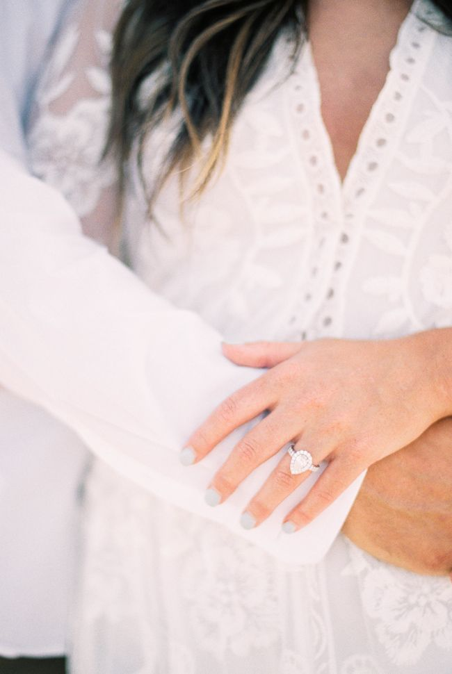 Romantic Okaloosa Island Engagement featuring a stunning pear shaped engagement ring