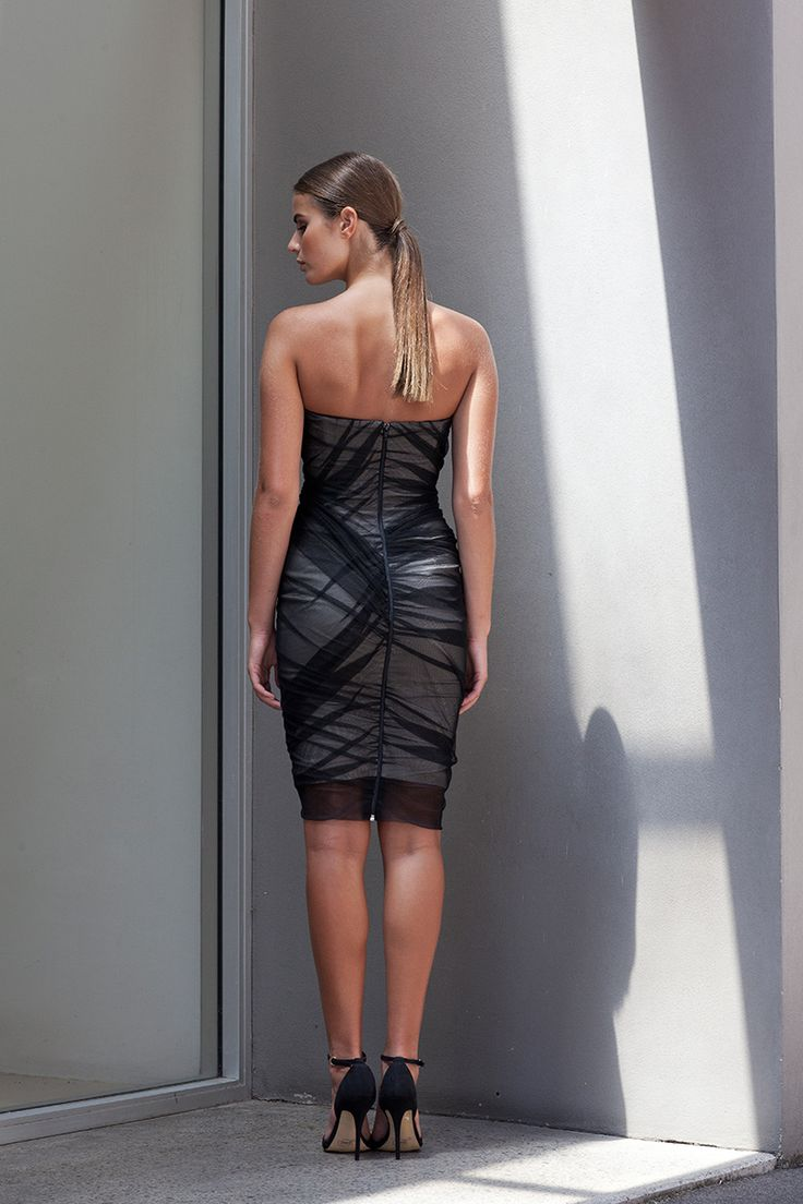 A strapless dress that features black mesh ruching over a chic beige base, the Fracture Ruched Mesh Dress is a structured style. With in-built bra cups and boning to ensure the perfect fit, this dress is the must have LBD for all occasions.
